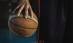 Close up of a hand holding a basketball