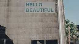 Wall with 'Hello beautiful' printed on it