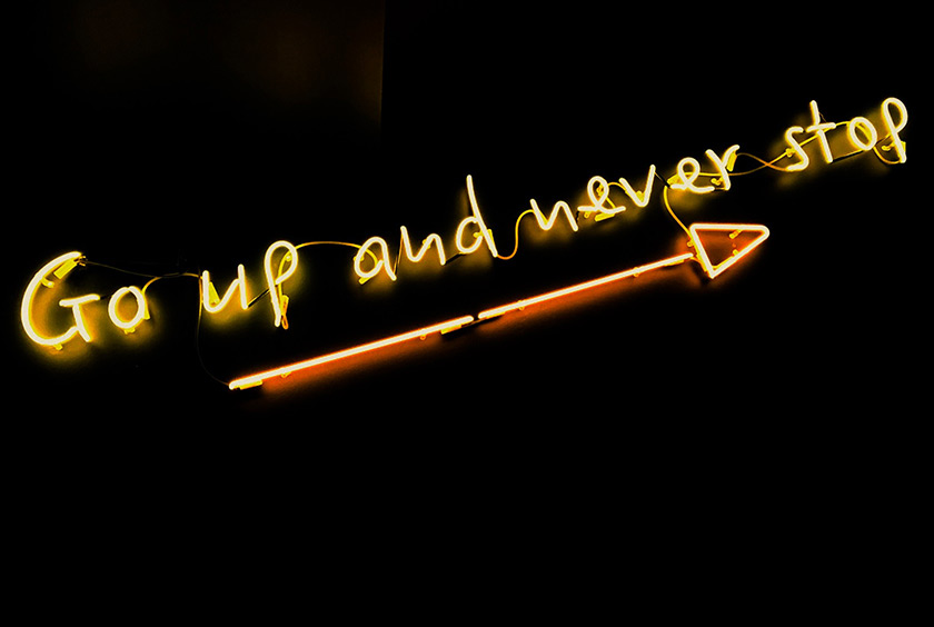 Go up and never stop illuminated sign